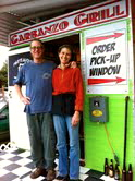 Jon Terry and Jeannine Navratil standing outside the Garbanzo Grill.