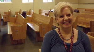 Lyn Cogswell in the chapel at Eugene Mission