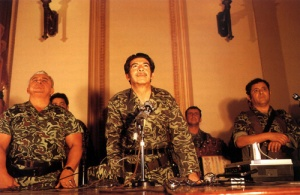 Brigadier General José Efraín Ríos Montt (center) post-coup press conference on March 23, 1982 in Guatemala City. Image courtesy of Wikimedia Commons.